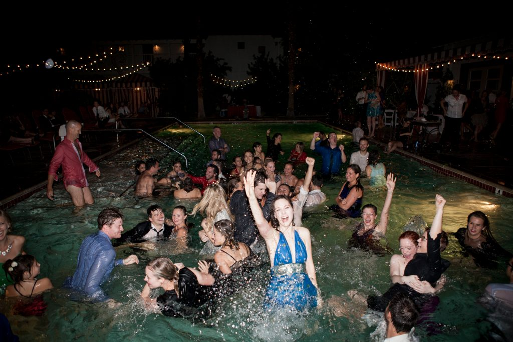 Pool full of wedding goers
